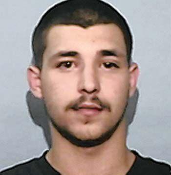 Authorities seek murder suspect