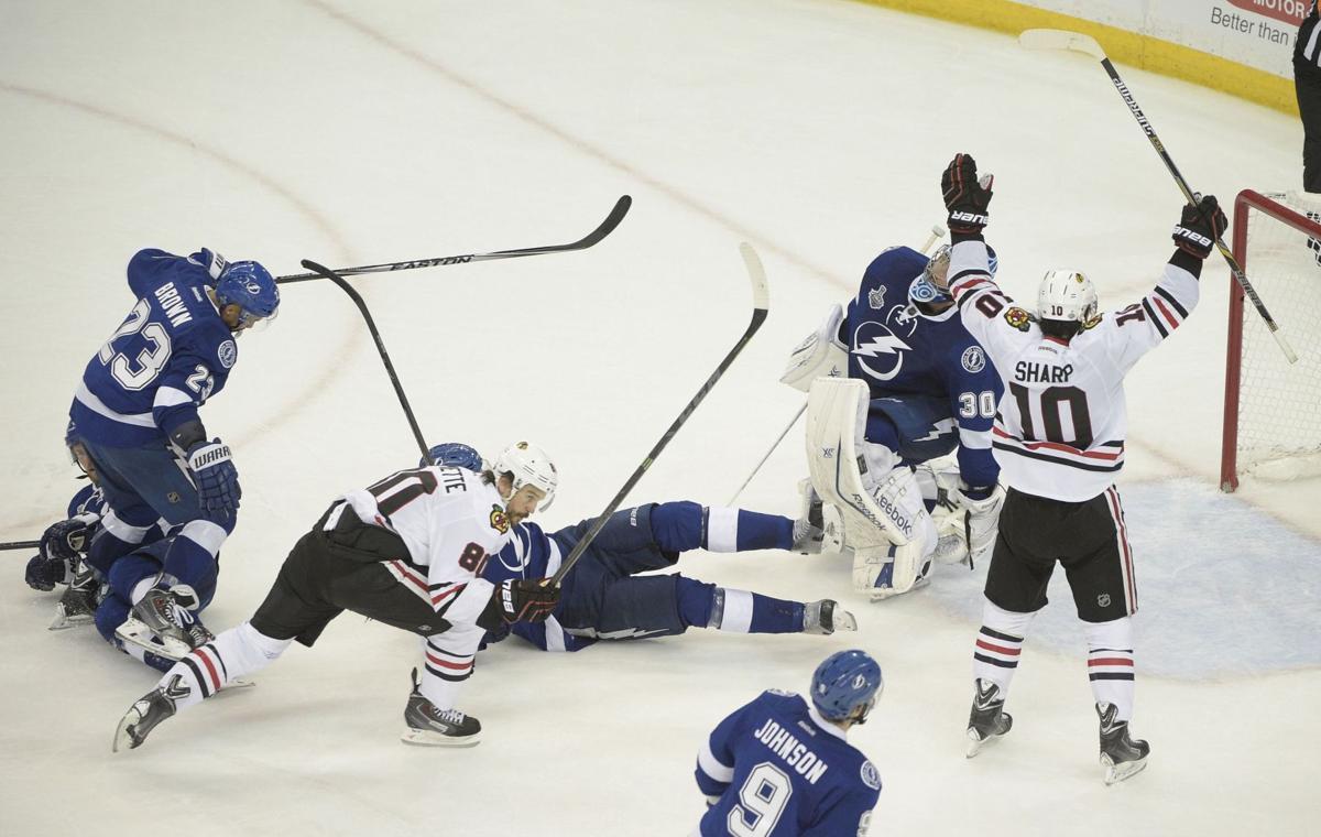 Blackhawks rally to stun Tampa Bay in Final opener