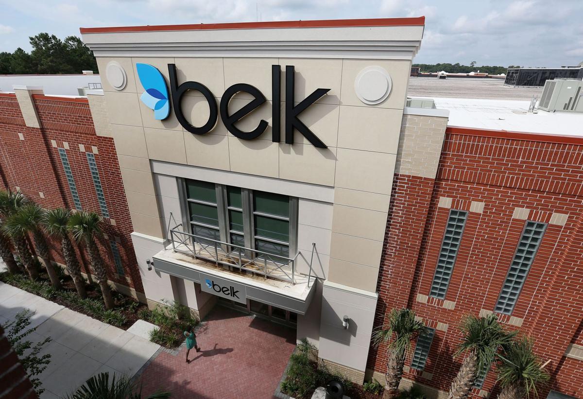Belk's profit slides, sales edge up
