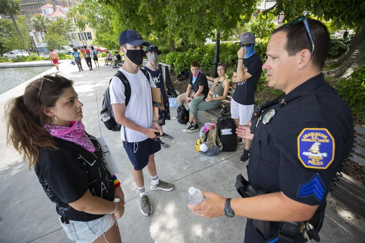 cop talking to protestors.jpg