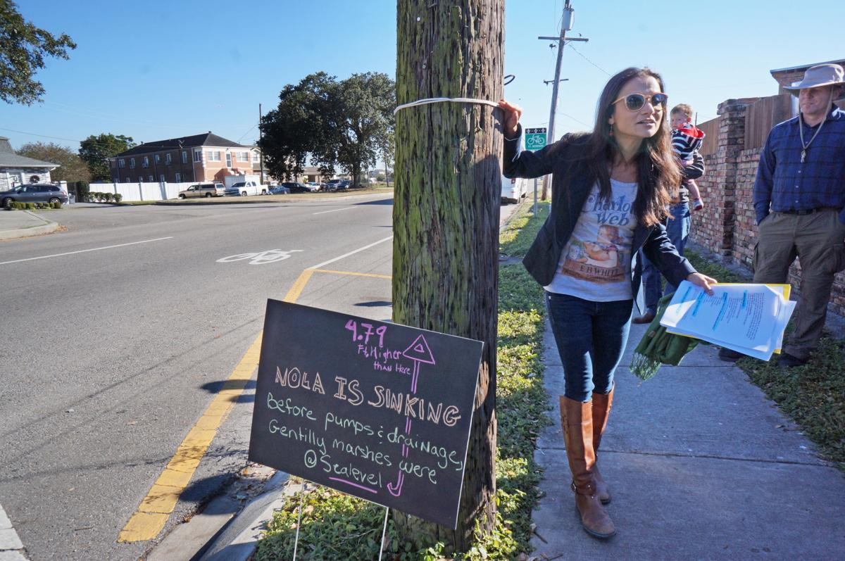 Julia Kumari Drapkin, founder of I See Change, by an area that's sinking in New Orleans