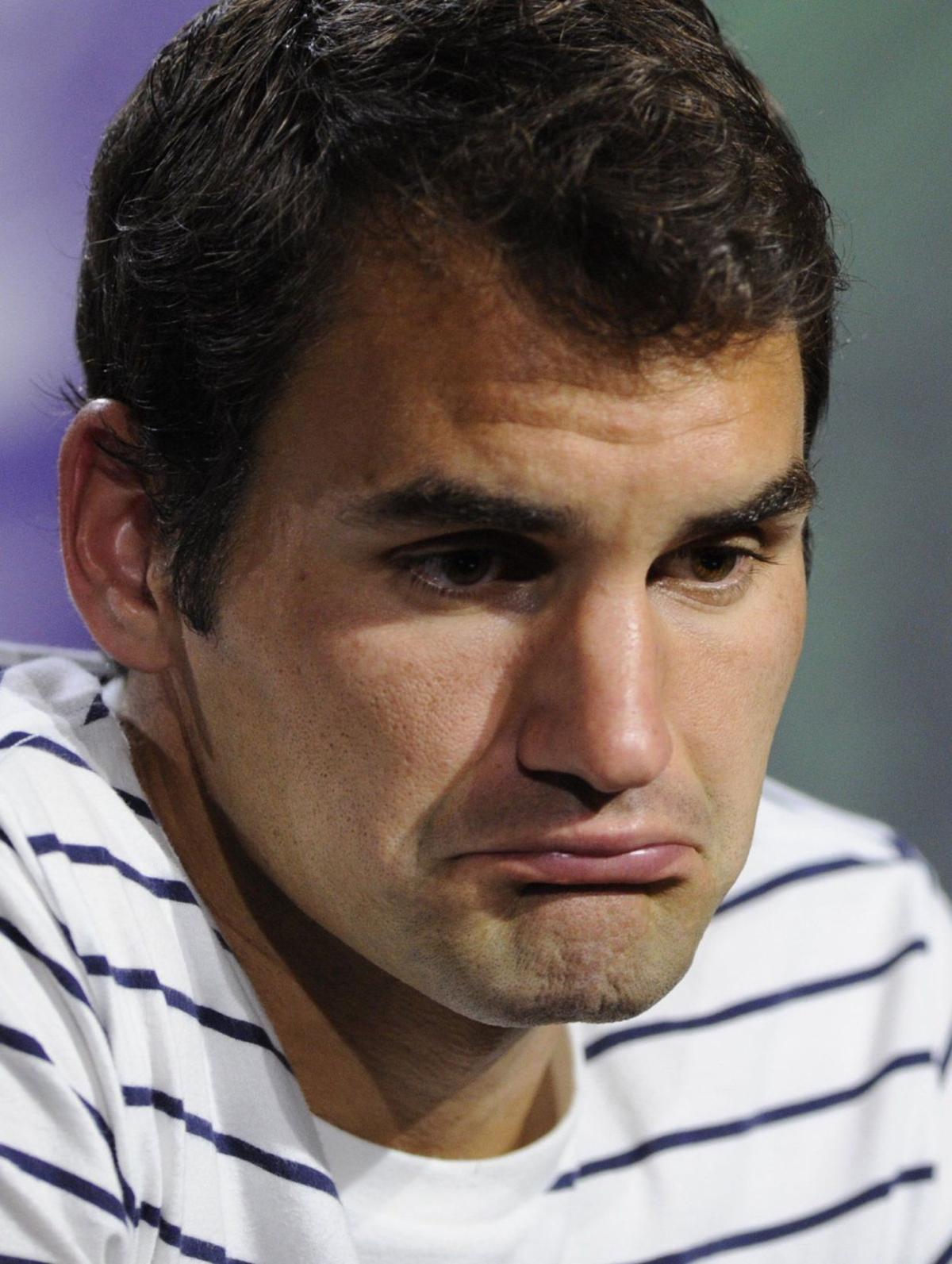 Federer upset in 2nd round at Wimbledon