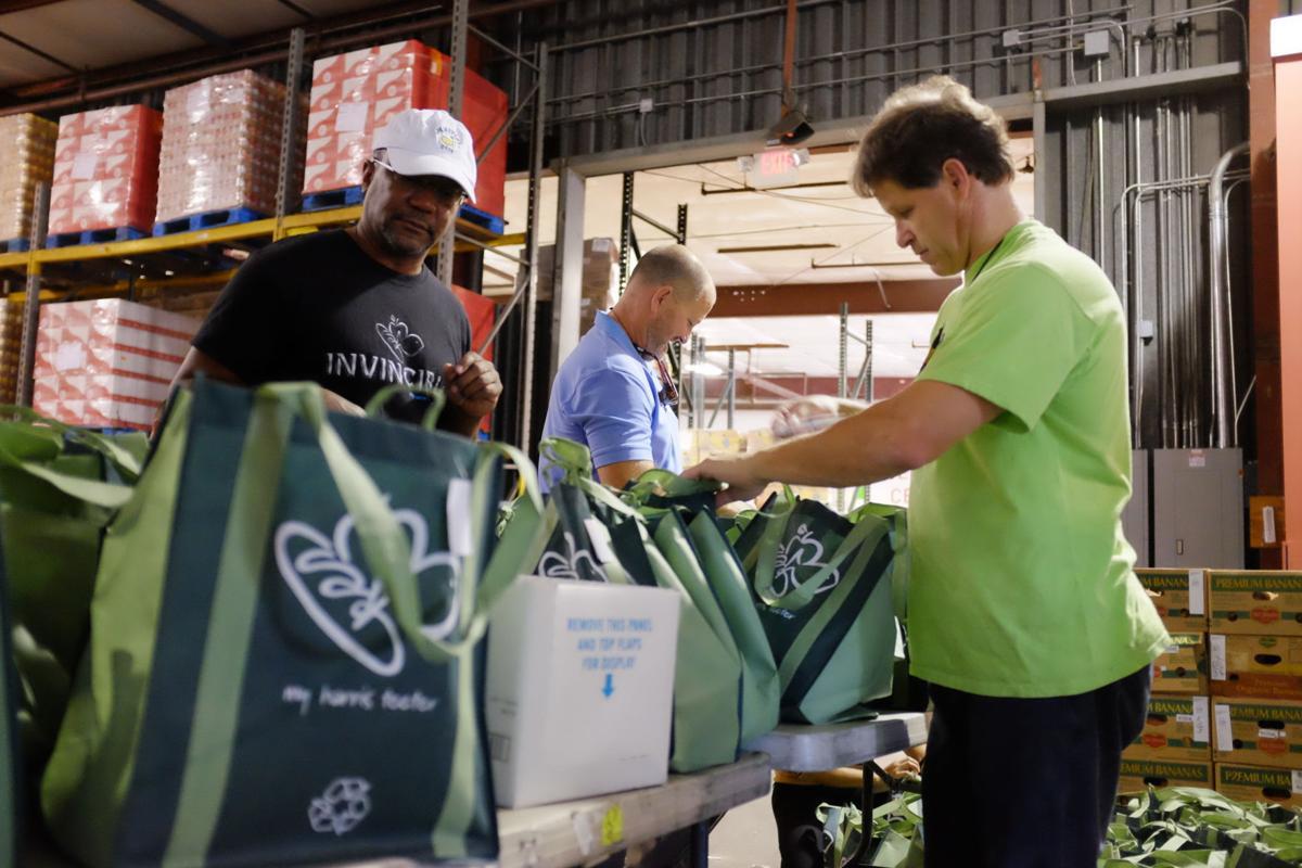 Harris Teeter volunteers work at the Lowcountry Food Bank