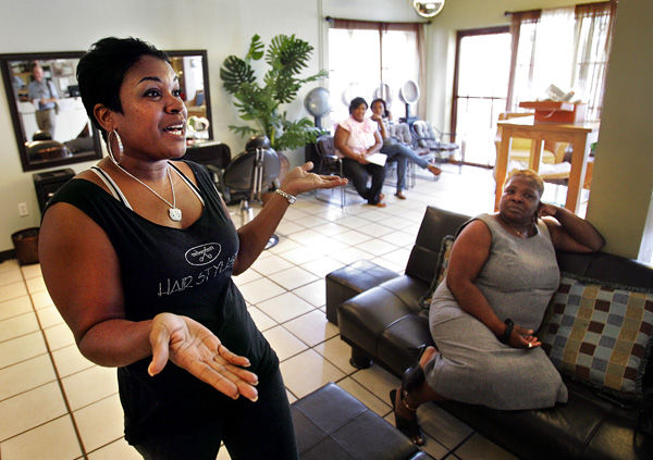 Still standing by Obama: Economy hurts, but local backers in black community vow to keep up fight