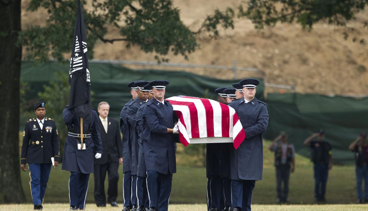 Military buries airmen killed in 1965 crash