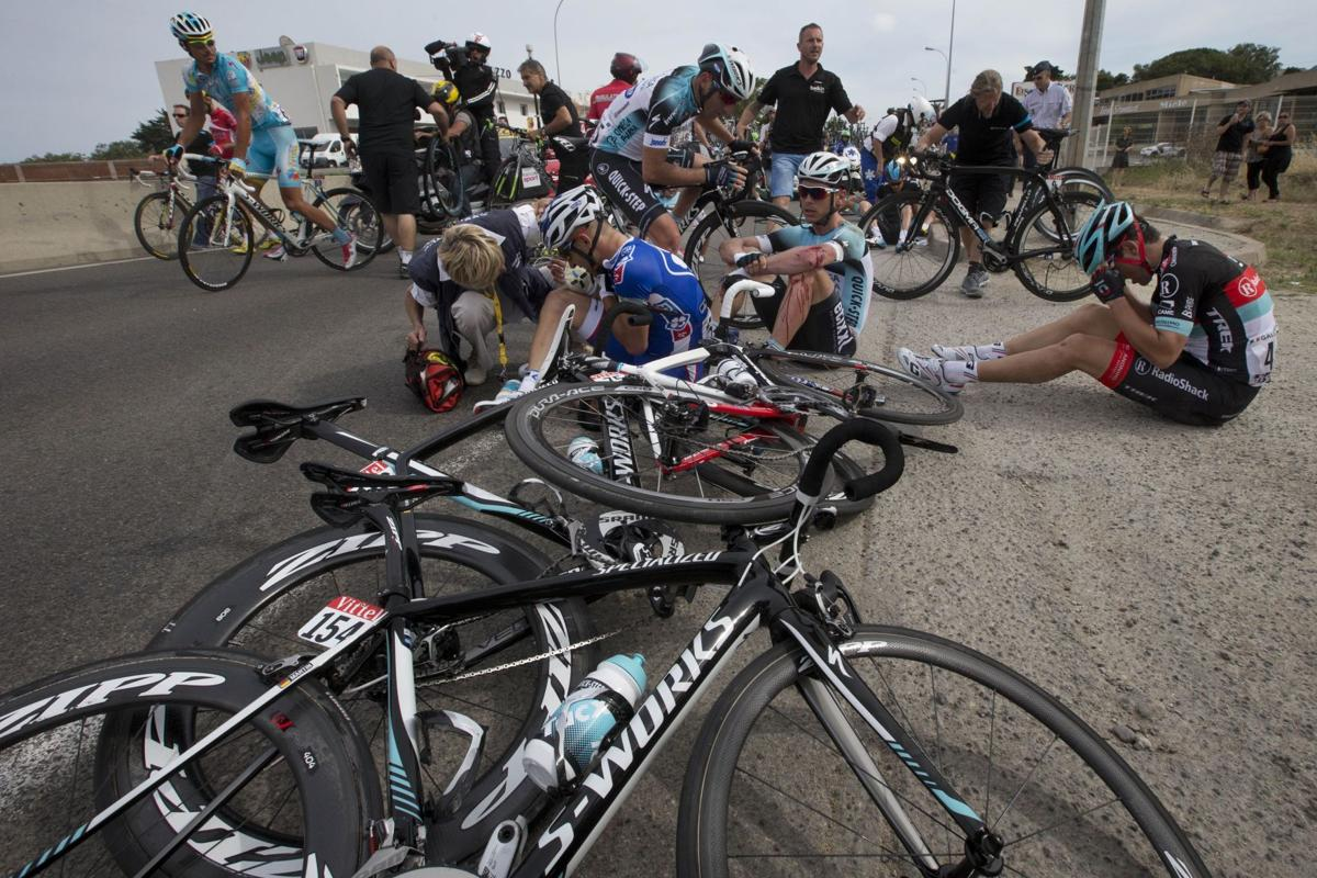 Chaos overshadows Tour de France A stuck bus, late wreck make for a tumultuous first stage