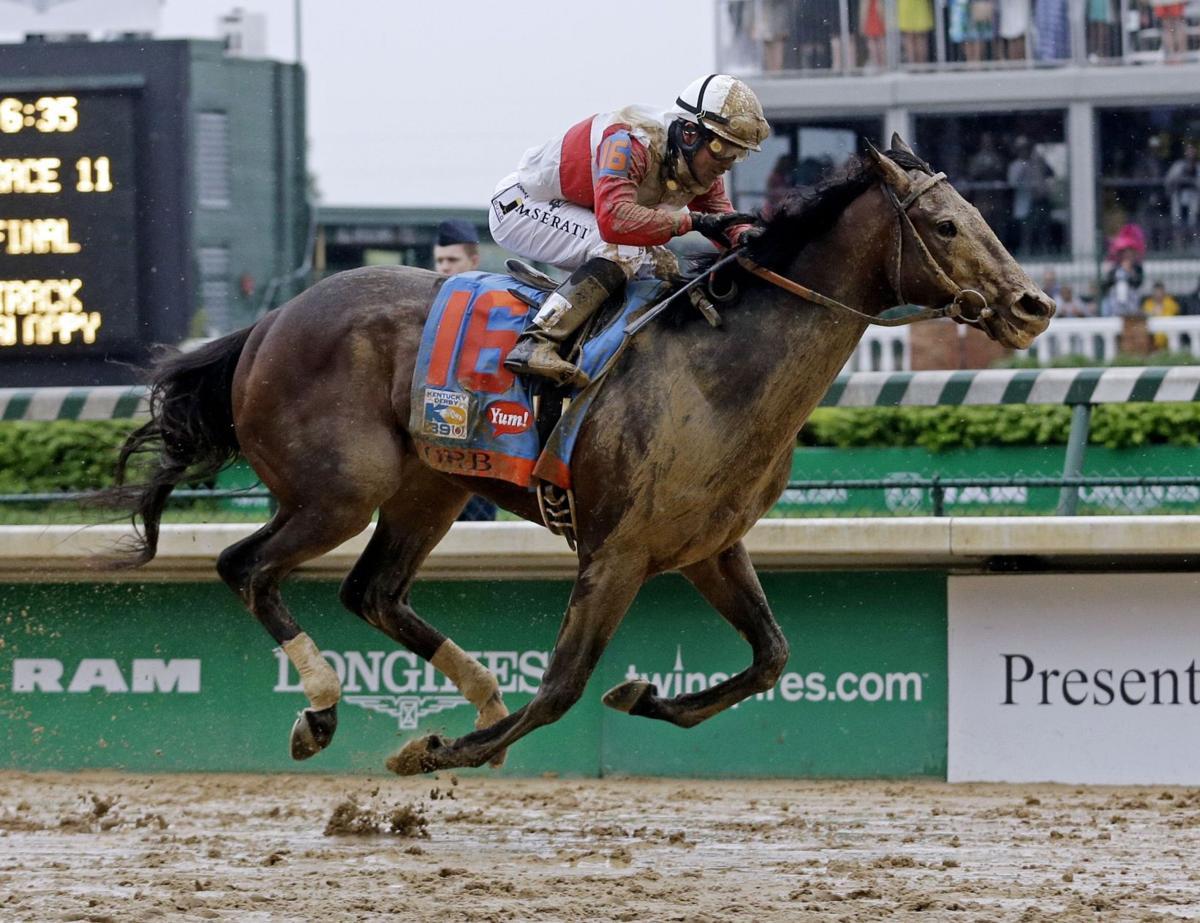 Orb wins dirty Derby