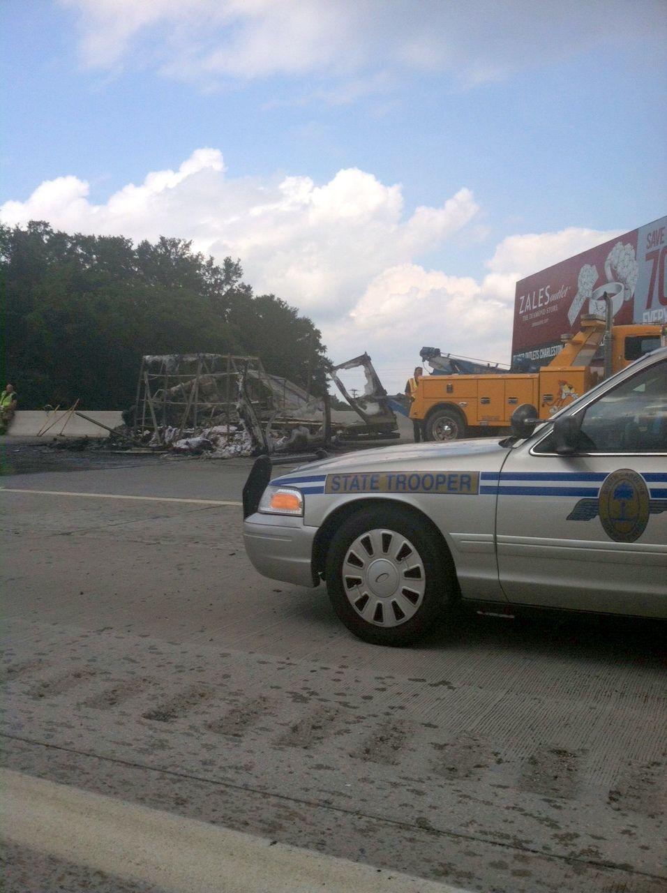 Burning van on interstate draws attention