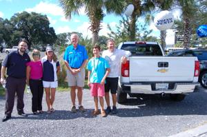 Local family wins full-sized pickup in national marine venture's essay contest