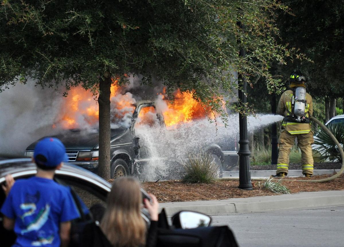 Firefighters put out vehicle fire near Wells Fargo bank branch in Mount Pleasant