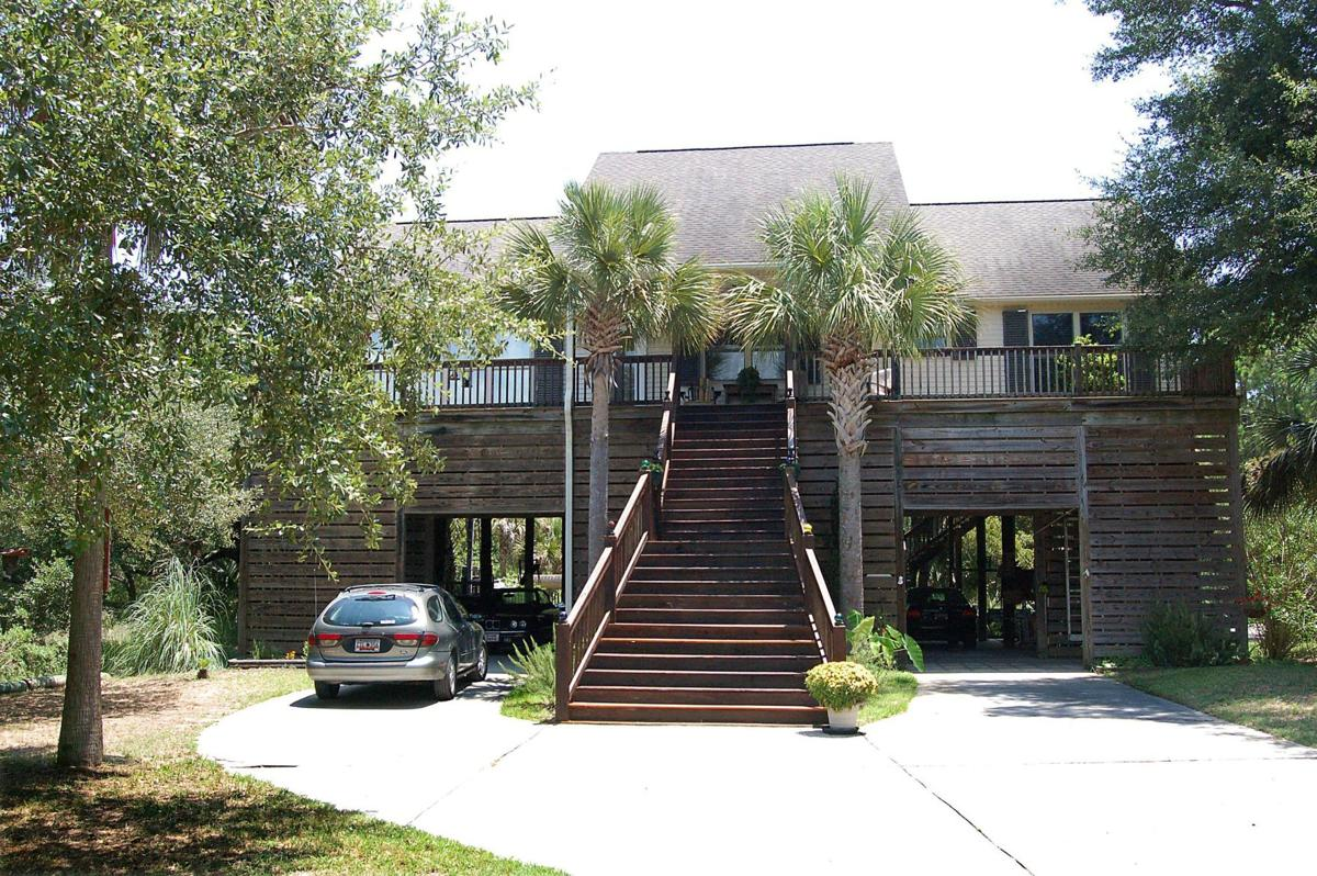 4 Red Sunset Lane - Inviting home in wooded Folly Beach nook shows off gourmet kitchen, upper-end fixtures, decks galore