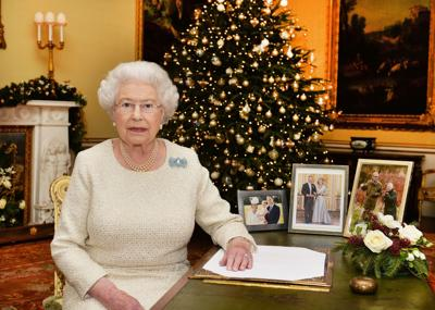 Queen honors stars and Ebola fighters