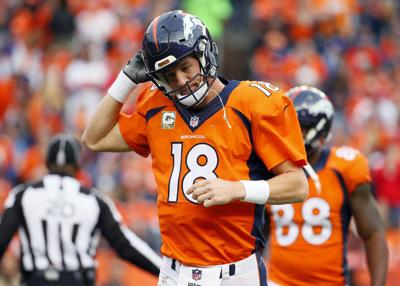 Manning sets mark, then gets benched