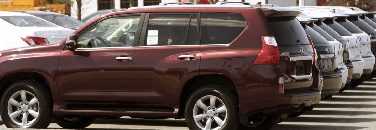 Automaker to pay record $16.4M fine, recall SUVs