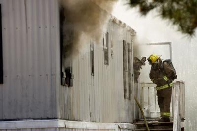 Good Springs Fire, Two Firefighters, Doorway