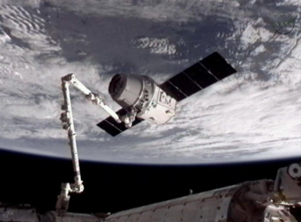 SpaceX capsule captured by space station crew in historic mission