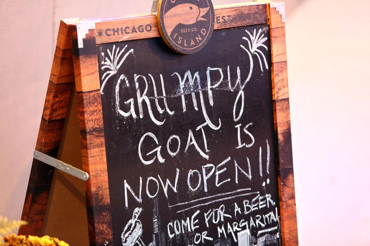 now open grumpy goat.jpg