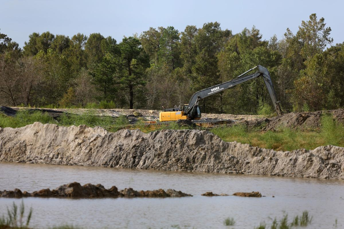 Rising SC floodwaters spill into Santee Cooper coal ash pit in ...