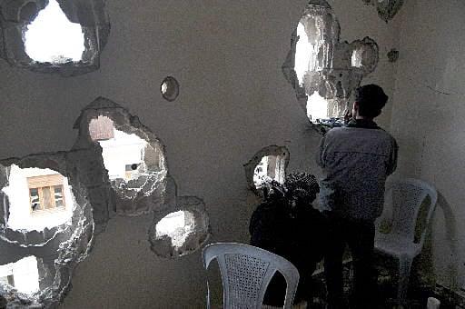 Syrians fire on protesters near monitors, kill 4