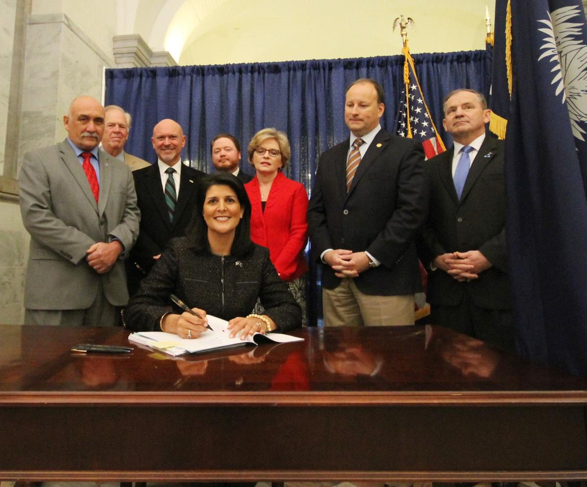 Gov. Haley signs guns in bars bill, expresses support for 'constitutional carry' (copy)