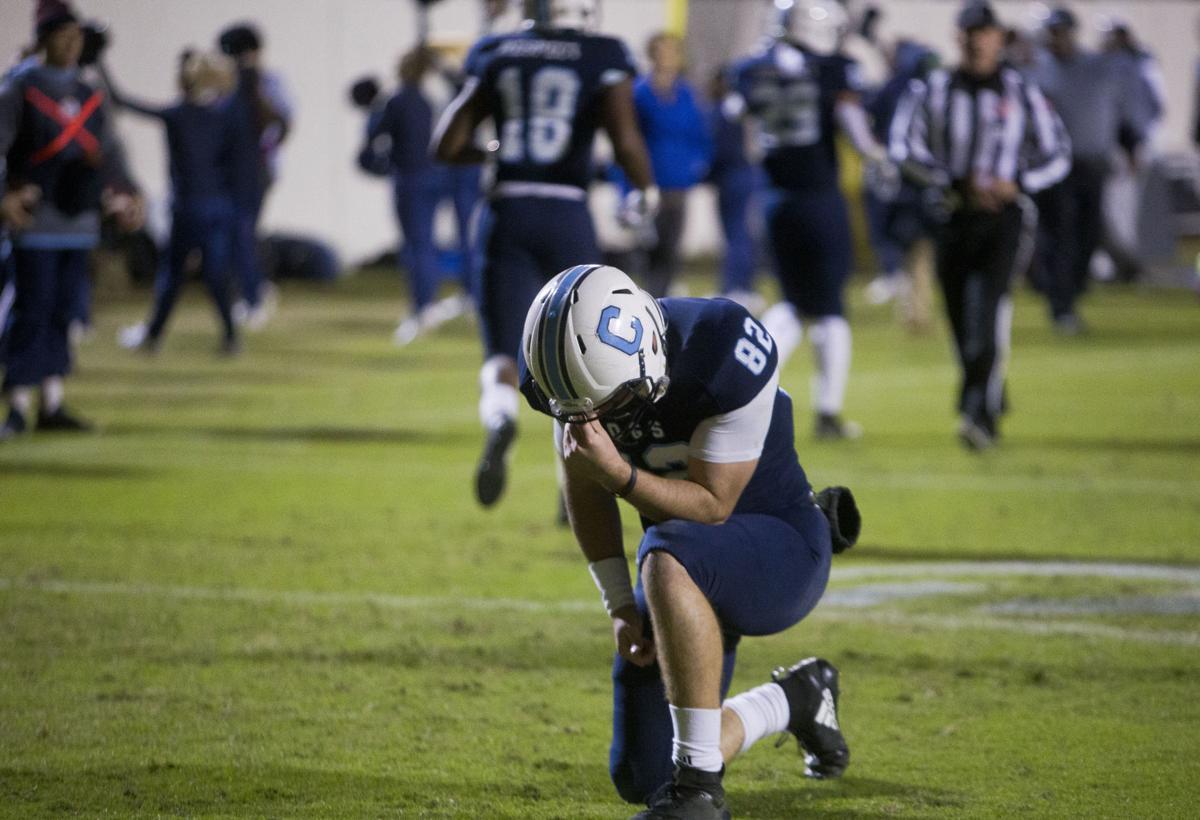 Brandon Rainey prays.JPG