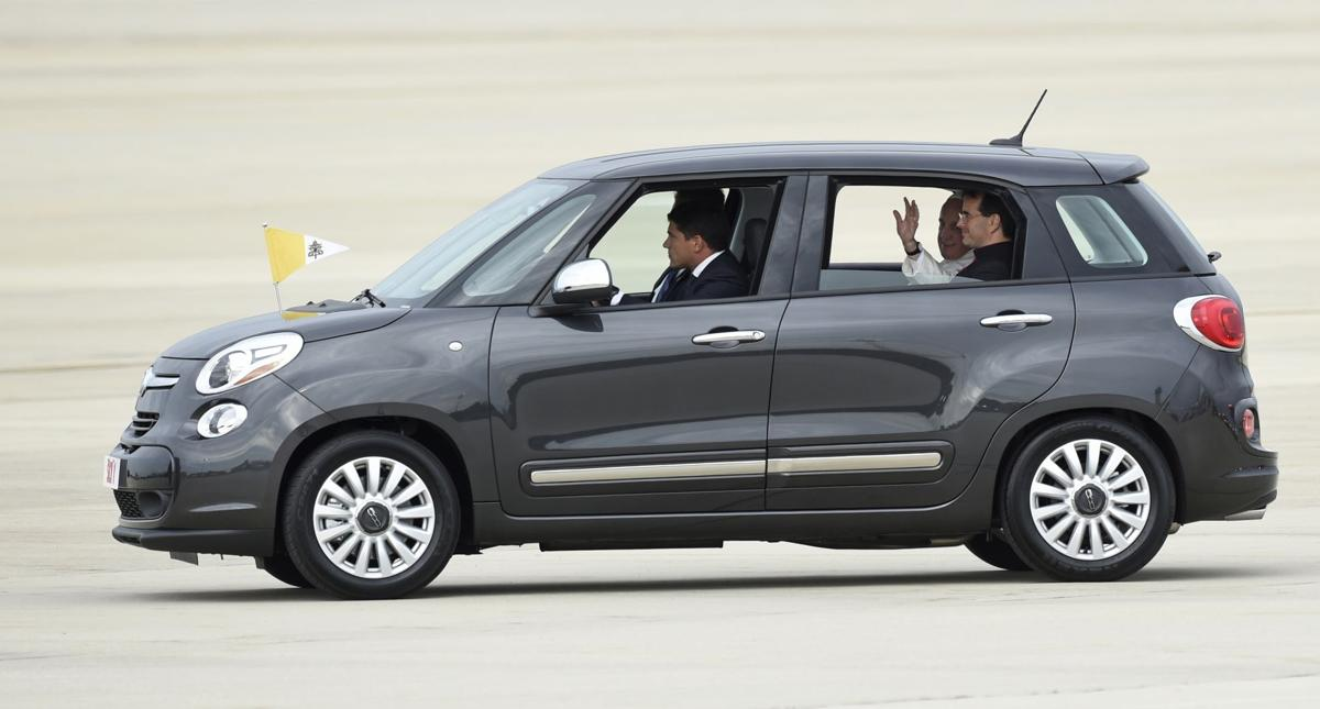 Arriving pope takes thrifty ride