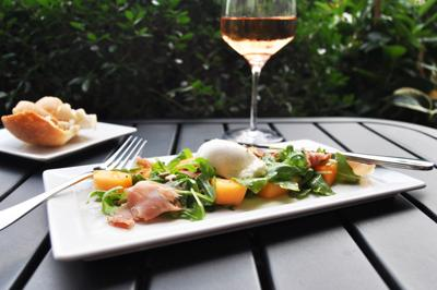 Melon, prosciutto and burrata salad at Tombo Grille