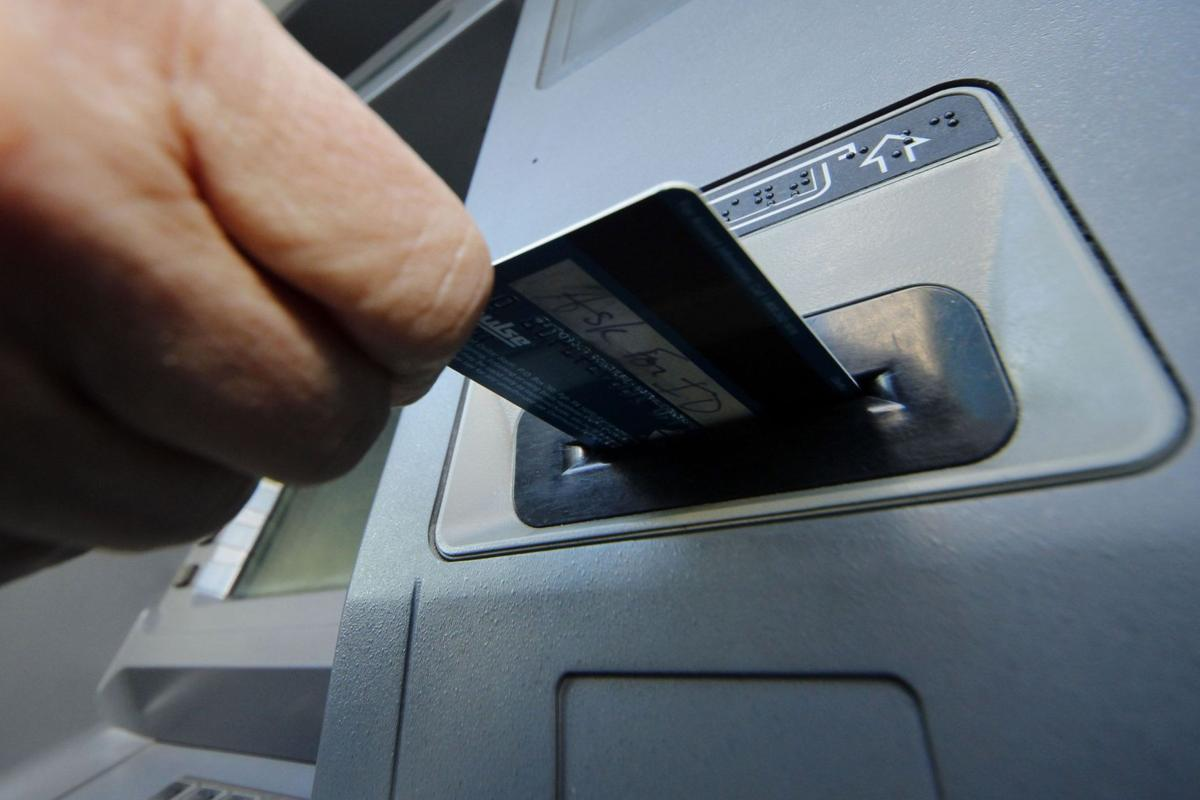 Hackers fool bank workers, loot $1 billion Latest breach caused ATMs to spew cash