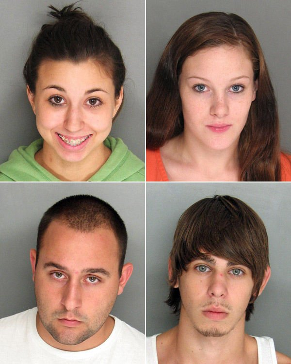 Four charged in shooting