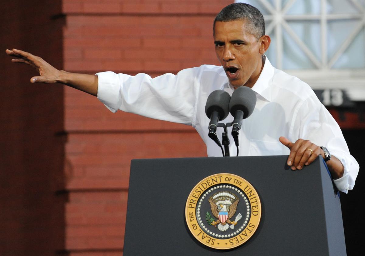 Obama unrelenting in bashing Romney's job record