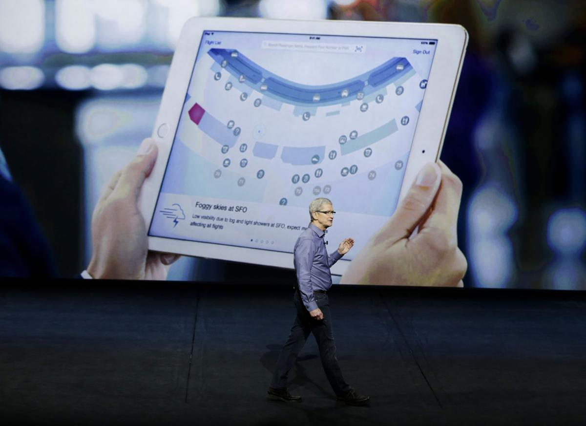 Apple stakes new claim to living room, shows new iPhones