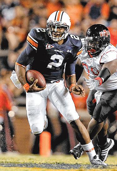 USC looks to contain Auburn QB Newton