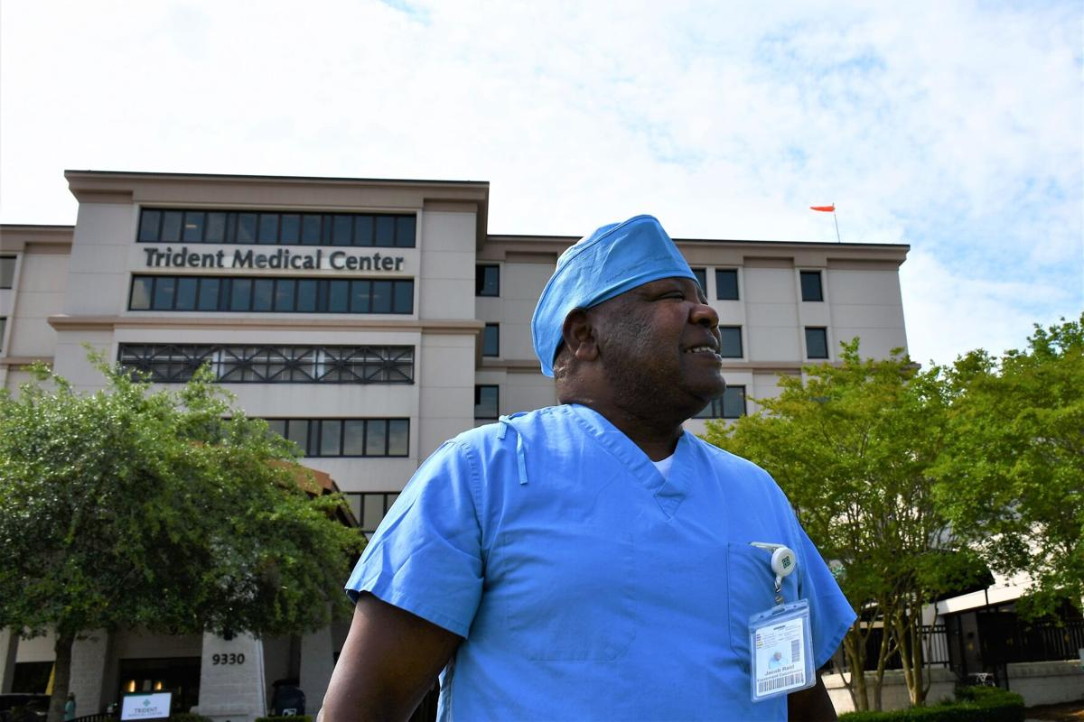 After long fight with COVID, hospital worker back on the job