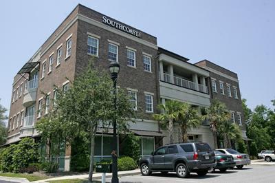 Scrutiny, suit delay local bank sale