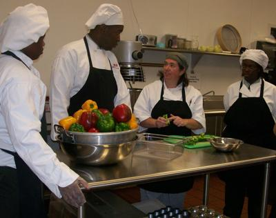 Military Magnet culinary students honor food bank's chef