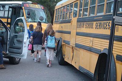 Truck strikes school bus, no one hurt
