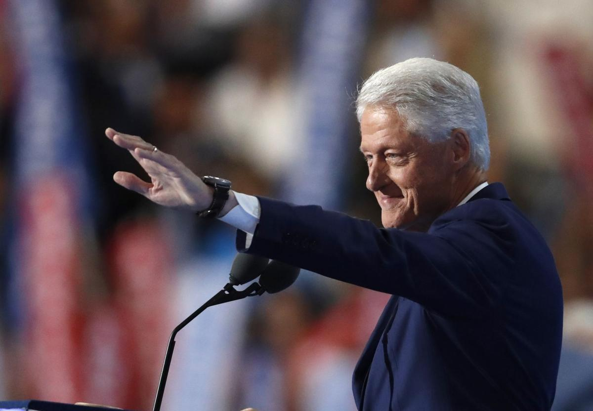Clinton wins historic nomination, emotional boost from Bill