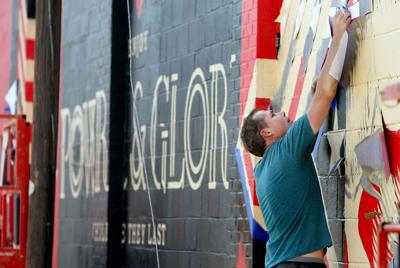 Shepard Fairey painting one of four murals in South Carolina