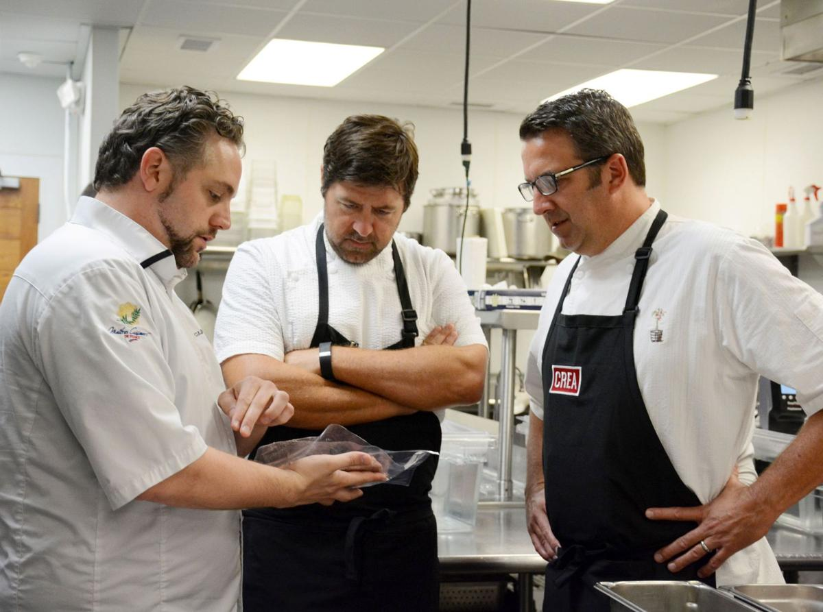 Local chefs study sous vide techniques in workshop
