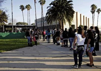Girl wounded in LA school shooting awakens
