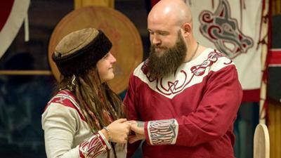 Sarah Logan and Raymond Rowe exchange vows