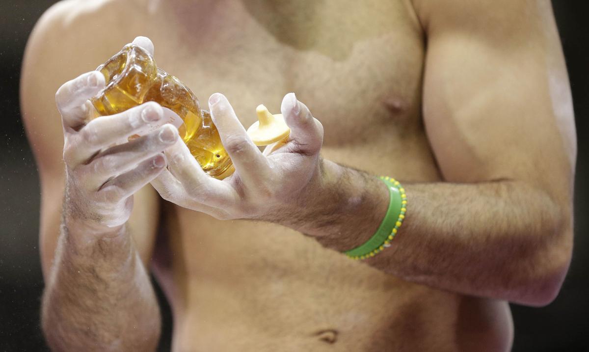 Gymnasts find unusual ways to maintain grip
