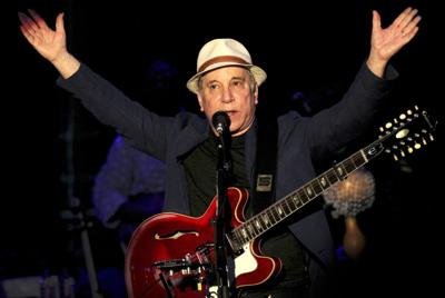 Paul Simon working with writer for biography