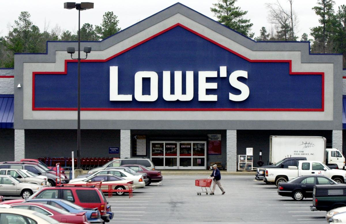 Lowe's 1Q profit up, but cuts 2012 profit outlook