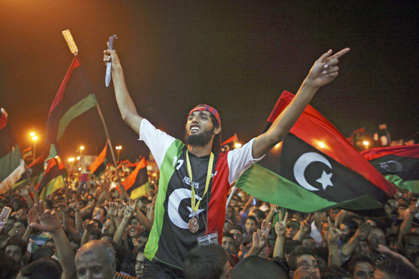 Clashes near Gadhafi compound in Libyan capital