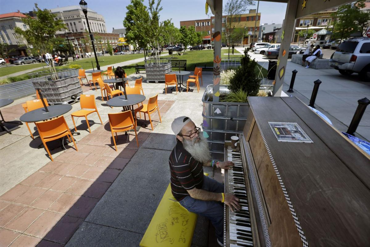 Players share the gift of music Piano brings a calm to Camden, N.J.
