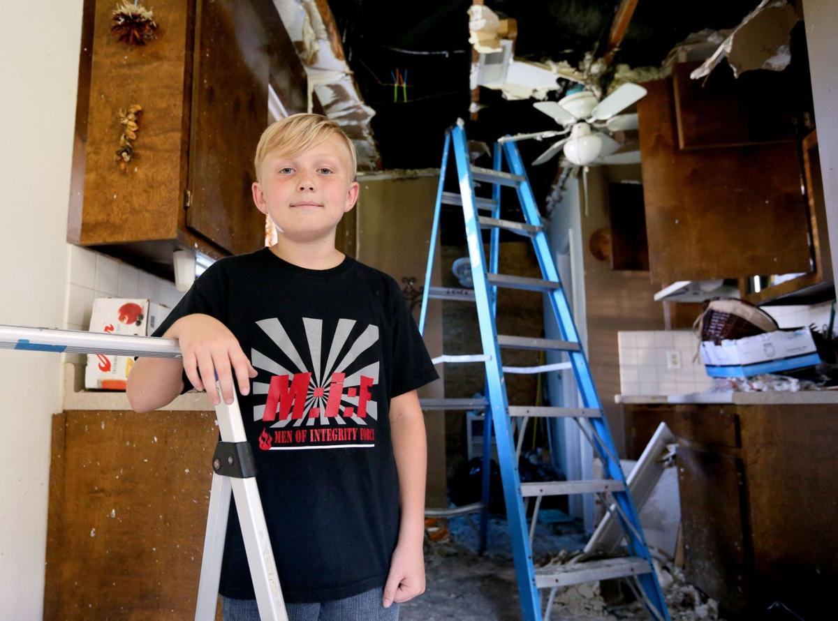Summerville boy, 11, saves family in house fire