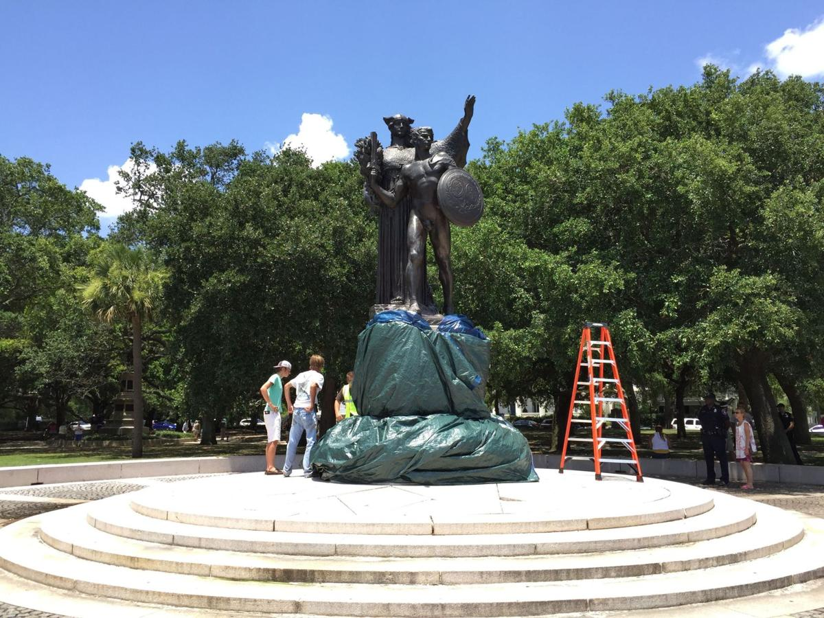 Confederate monument a focus of debate after graffiti appears People then cover words with tarp, more messages