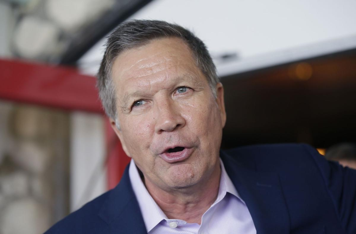 Kasich touts record — and dance skills — in Iowa
