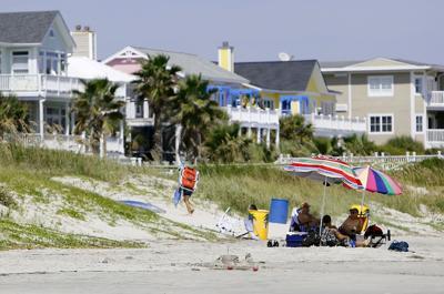 Area beaches boom, despite shark scares